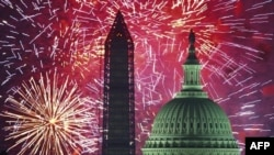 Independence Day fireworks are seen over the US Capitol and Washington Monument in Washington, DC