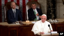 Pope Francis addresses a joint meeting of Congress on Capitol Hill in Washington, making history as the first pontiff to do so, Sept. 24, 2015.
