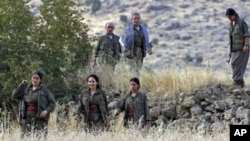 Members of the Kurdistan Workers' Party, or PKK, are seen in the Qandil mountain range, Iraq (File Photo - August 13, 2011)