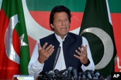 FILE - Pakistan's opposition leader Imran Khan speaks during a press conference in Islamabad, Pakistan, April 10, 2016.
