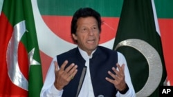 FILE - Followers of Pakistani opposition leader Imran Khan, shown at an April press conference, have planned a demonstration seeking the resignation of Prime Minister Nawaz Sharif. The government on Thursday banned political gatherings in Islamabad.