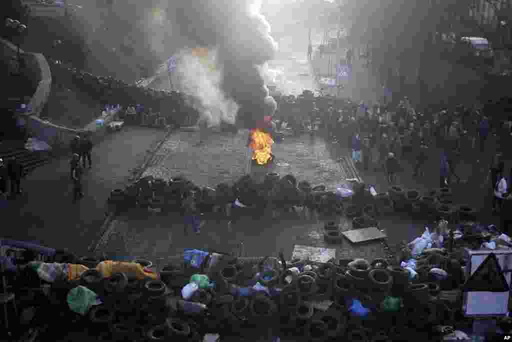 A fire burns at the barricades on the outskirts of Independence Square in Kyiv, Feb. 21, 2014.