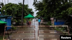 A street blocked by barricades is seen amid the outbreak of the coronavirus disease (COVID-19), in Sittwe, Rakhine State, Myanmar August 24, 2020. REUTERS/Stringer NO RESALES NO ARCHIVES