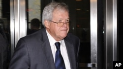 FILE - Former U.S. House Speaker Dennis Hastert leaves the federal courthouse, Oct. 28, 2015, in Chicago, Illinois, where he changed his plea to guilty in a hush-money case that alleges he agreed to pay someone $3.5 million to hide claims of past misconduct.