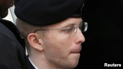 U.S. soldier Bradley Manning is escorted into court to receive his sentence.