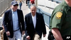 U.S. Senator John McCain, left, and Senator Charles Schumer tour the Nogales port of entry during their tour of the Mexico border with the United States, March 27, 2013, in Nogales, Arizona.