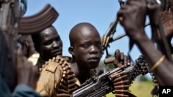 FILE - South Sudan government soldiers in the town of Koch, Unity state, South Sudan. The government of Sudanese President Omar al-Bashir says it has never used children in armed conflicts.
