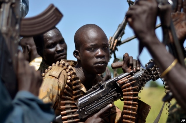 FILE - South Sudan government soldiers in the town of Koch, Unity state, Sept. 25, 2015.