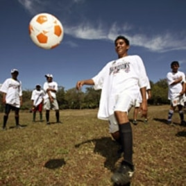 Members of Nicaragua's Buena Vista soccer team, a local soccer team, train after receiving T-shirts with graphics depicting the New England Patriots NFL team as the winners of Super Bowl XLII, in San Gregorio village, south of Managua. The NFL donated the