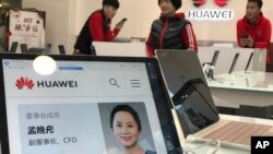 FILE -- A profile of Huawei Chief Financial Officer Meng Wanzhou is displayed on a Huawei computer at a Huawei store in Beijing, Dec. 6, 2018.