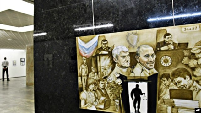 A painting of fallen Russian oligarchs Mikhail Khodorkovsky and Platon Lebedev is displayed at the Central House of Artists in Moscow (file photo)