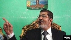 Mohamed Morsi (file photo, E. Arrott/VOA)