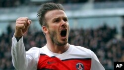 An April 6, 2013 photo, shows PSG's David Beckham celebrating after scoring a goal against Rennes during their French League One soccer match, in Rennes, western France.