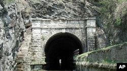 This is the famous Paw Paw Tunnel on the canal, through which boats could travel only one way at a time. The tunnel bypasses a section of the Potomac River containing five horseshoe bends.