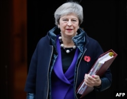 Britain's Prime Minister Theresa May leaves 10 Downing Street in London on Oct. 31, 2018, ahead of the weekly Prime Minister's Questions session in the House of Commons.