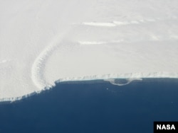 Calving front of an ice shelf in West Antarctica taken on a NASA mission focused on gatering data for the new ice shelf study.
