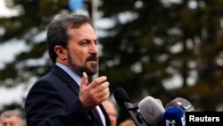 FILE- Syrian National Coalition spokesperson Louay Safi addresses the media after a meeting at the Geneva Conference on Syria, February 15, 2014.