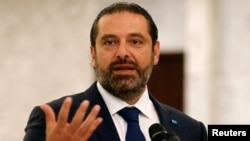 FILE - Lebanese Prime Minister-designate Saad al-Hariri looks on as he speaks at the presidential palace in Baabda, Lebanon, Sept. 3, 2018.