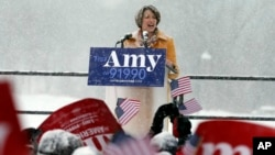 Democratic Sen. Amy Klobuchar addresses a snowy rally where she announced she is entering the race for president, Feb. 10, 2019, at Boom Island Park, in Minneapolis, Minnesota.