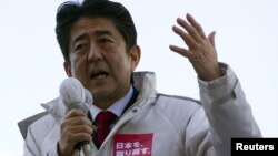 Japan's main opposition Liberal Democratic Party's (LDP) leader and former Prime Minister Shinzo Abe makes a speech during a campaign for the December 16 lower house election in Ageo, north of Tokyo, December 11, 2012.