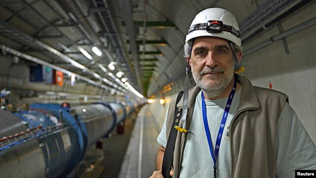 Simon Baird, deputy head of CERN's engineering department, poses in the LHC tunnel during a visit at the Organization for Nuclear Research (CERN) in Meyrin, near Geneva, April 10, 2013.