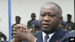 Ivory Coast's President Laurent Gbagbo attends an official funeral ceremony in Abidjan in this November 15, 2003 file photo. Ivory Coast's incumbent leader Laurent Gbagbo has been arrested, a spokeswoman for forces loyal to his rival presidential claimant