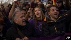 People shout slogans during a Podemos party march in Madrid, Jan. 31, 2015.