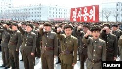 North Koreans attend a rally against the United States and South Korea in Nampo, April 3, 2013.