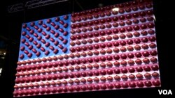 The Super Bowl is the most-watched American sporting event of the year. This American flag has been decorated with Wilson footballs. The company manufactures every football that is used by the NFL. (B. Allen/VOA)