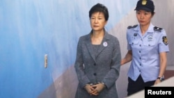 FILE - Former South Korean President Park Geun-hye arrives at a court in Seoul, South Korea, Aug. 25, 2017.