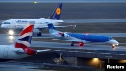 FILE - A British Midland Airways (bmi) aircraft, a plane by Lufthansa and an airplane of the British Airways are seen at the international airport in Munich, Germany, Jan. 9, 2018.