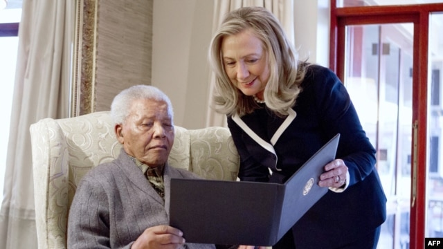 US Secretary of State Hillary Rodham Clinton meets with Nelson Mandela, 94, former president of South Africa, at his home in Qunu, South Africa, on August 6, 2012.