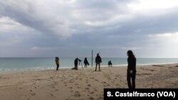 Team shooting with migrants on Stignano beach, Calabria, Italy.