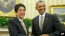 President Barack Obama shakes hands with Japan's Prime Minister Shinzo Abe in the Oval Office of the White House, Feb. 22, 2013.