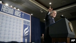 President George W. Bush takes a question from the audience at Freedom House, Wednesday, March 29, 2006 in Washington, DC.