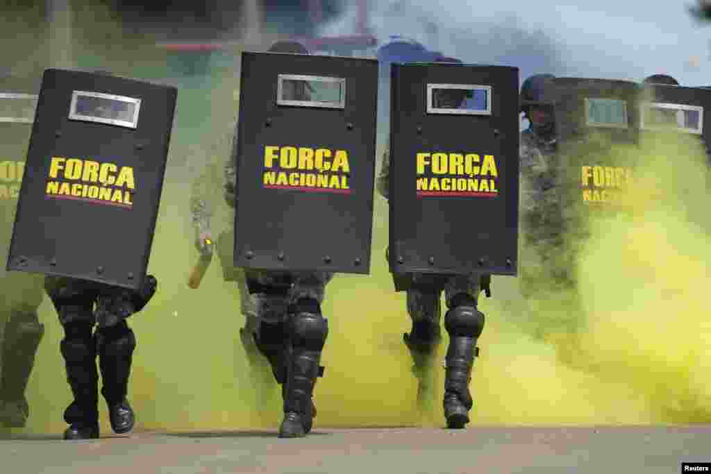 Members of the National Security Force practice crowd control during training to provide security at the 2014 World Cup, in Brasilia, Brazil. The World Cup will be held in 12 cities in Brazil in June.