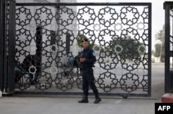 FILE - A member of the Palestinian security forces stands guard at the Rafah border crossing with Egypt in the southern Gaza Strip, Sept. 26, 2018.