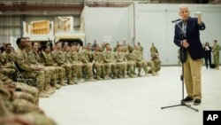 U.S. Defense Secretary Chuck Hagel speaks to members of the military during his visit to Bagram Airfield in Bagram, Afghanistan, June 1, 2014.