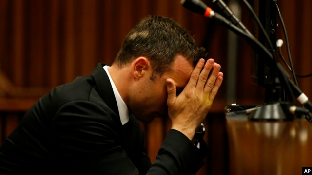 Oscar Pistorius sits in the dock in court on the third day of his trial at the high court in Pretoria, South Africa, Wednesday, March 5, 2014.