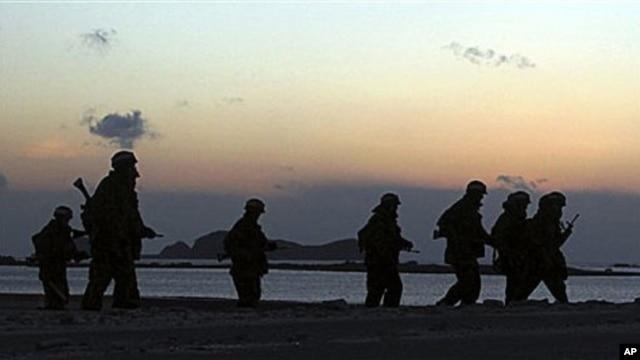 South Korean Marines patrol along a beach on Yeonpyeong Island, South Korea, 15 Dec 2010