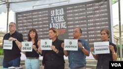 Members of the international media and the wife of one of the mass murder victim gathered in Quezon City, Philippines, last month.