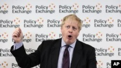 Britain's Foreign Secretary Boris Johnson wipes his forehead as he delivers a speech at the Policy Exchange in London, Wednesday Feb. 14, 2018.