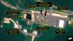 This July 22, 2018, satellite image released and annotated by 38 North on Monday, July 23, shows what the U.S. research group says is the partial dismantling of the rail-mounted transfer structure, at center, at the Sohae launch site in North Korea. (Airbus Defense & Space/38 North via AP)
