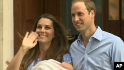 In this image from video, The Duke and Duchess of Cambridge leave the Lindo Wing of St Mary's Hospital in London, July 23 2013, carrying their new-born son, the Prince of Cambridge who was born Monday, into public view for the first time.