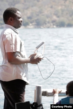 Malawi freelance journalist Eldson Chagara flies his drone above Lake Malawi in Mangochi district in this undated photo. (Photo courtesy of Eldson Chagara)