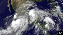 FILE - Hurricane Ingrid in the Gulf of Mexico approaching the coast of Mexico and tropical storm Manuel just off the western coast of Mexico, 15, 2013.