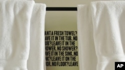 Hotel guests are reminded to save the planet, by keeping their used towels, when they step into the shower.