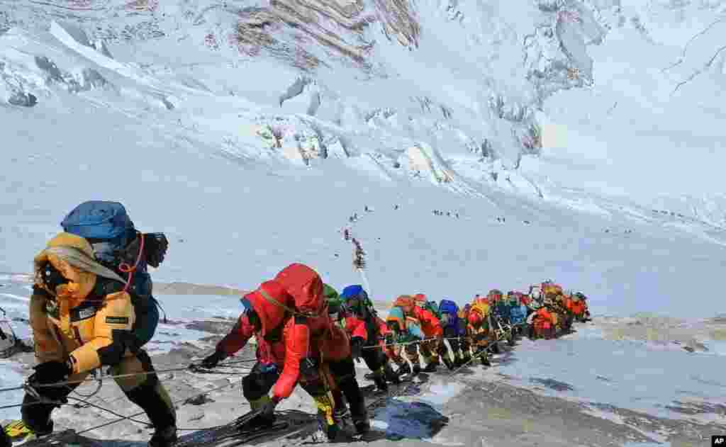 A long queue of mountain climbers line a path on Mount Everest just below camp four, in Nepal. Seasoned mountaineers say the government's failure to limit the number of climbers on Mount Everest has resulted in dangerous overcrowding and a greater number of deaths.