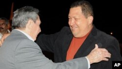 In this photo released by Cuba's state-run Granma newspaper, Cuba's President Raul Castro, left, welcomes Venezuela's President Hugo Chavez upon his arrival to Havana, Cuba, Friday Feb. 24, 2012. Chavez arrived in Cuba for urgent surgery to remove a tumor
