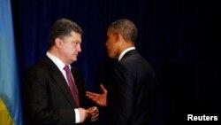 6月4日,奥巴马总统在华沙会见乌克兰当选总统波罗申科。